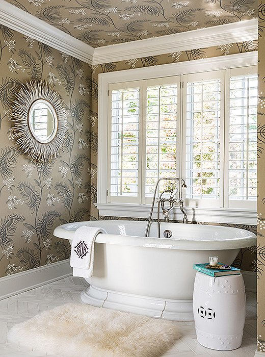 "Sue got to indulge in another of her many ""wallpaper crushes"" in the master bathroom."