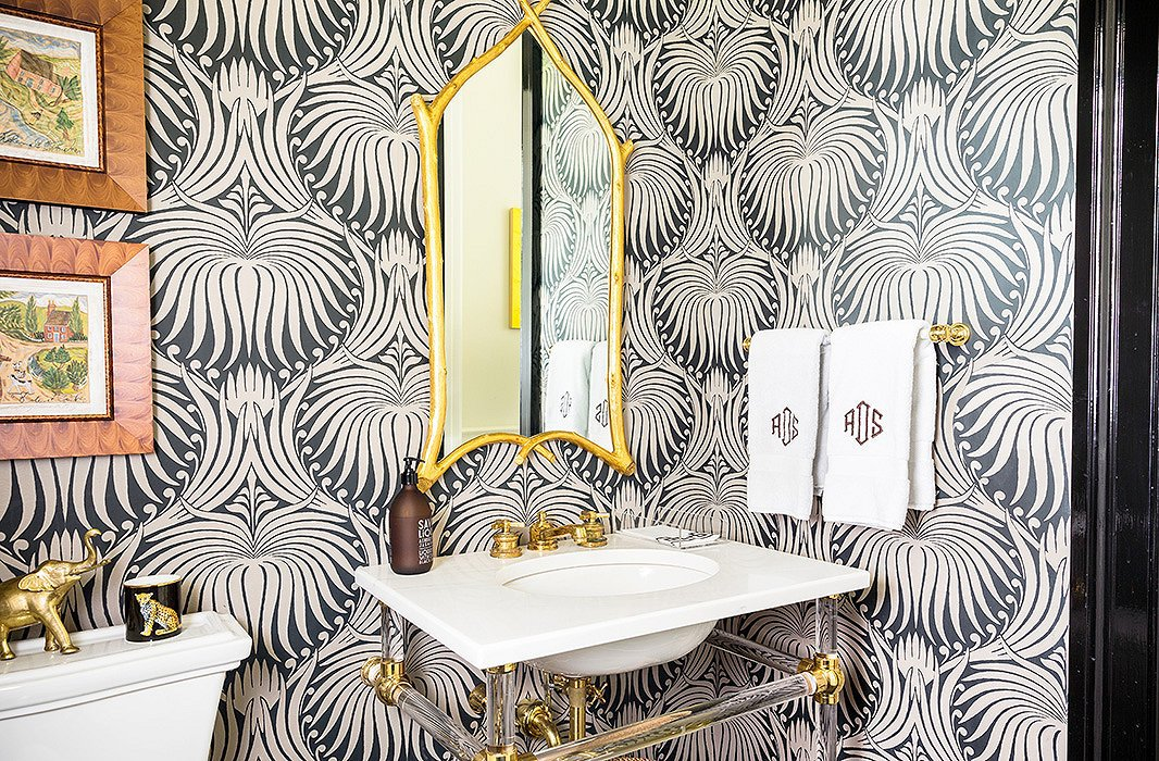 "Farrow & Ball's Lotus motif covers the walls of this powder room. Sue recommends Googling any wallpaper you like, to ""see it in as many room situations as possible. It's so much better than trying a little sample on the wall."""