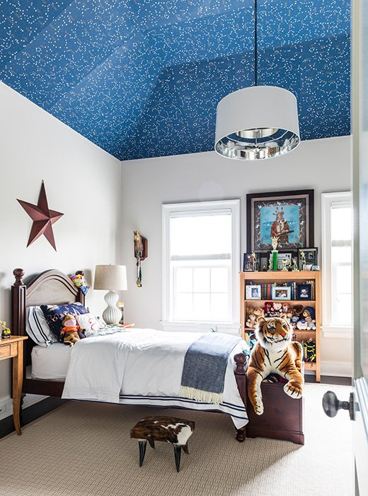 With next-level wallpaper having a moment, it's hard not to consider the ceiling's constellation paper, which glows in the dark, the ultimate pick.