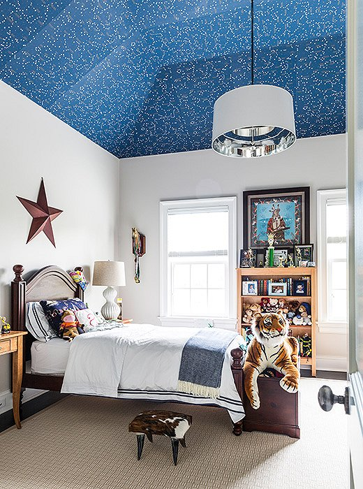 Whether it's a pretty floral print or glow-in-the-dark constellations, a fun removable wallpaper is an easy—and low-commitment—way to add a little something extra in your child's room.  Photo by Lesley Unruh.