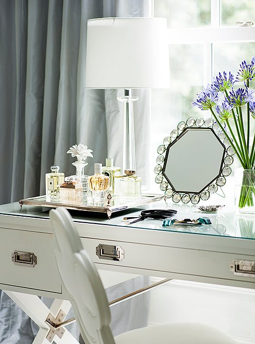 A desk designed by Suzanne for Hickory Chair stands in as a dressing table in the master bath.