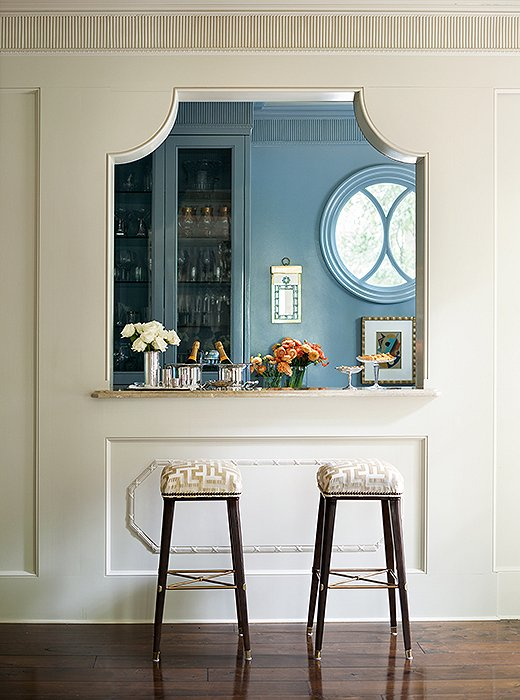 Guests gravitate to the butler's pantry and bar, which has a jewellike appearance when glimpsed from the dining room.