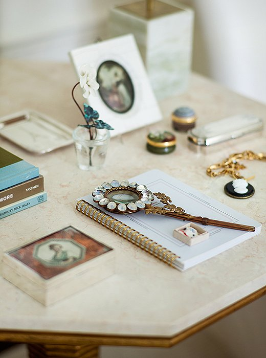 Suzanne's eye for composing vignettes comes through at every turn, including this delicately arranged side table.