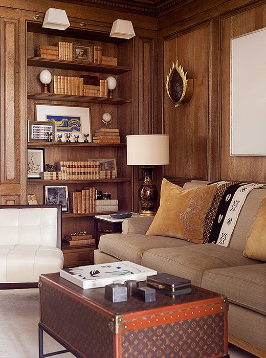 A vintage Louis Vuitton trunk-turned-coffee table nods to Suzanne's love of fashion, while its rich hues add to the library's cozy feel.