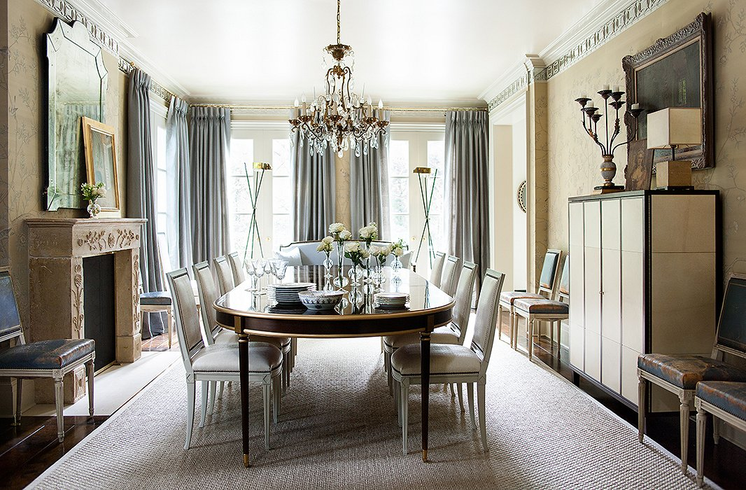 The dining room sparkles, thanks in part to mirrored molding that runs around the cornice line. Suzanne used a metallic paint on the ceiling to capture even more light.