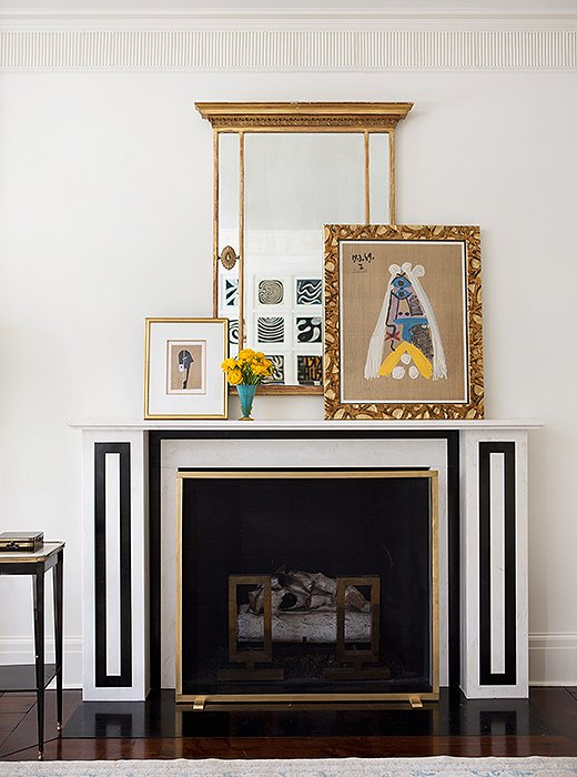 The living room mantel, one of three added to the house, was modeled on an 1824 drawing in the archives of Sir John Soane's Museum. Paintings casually leaned on the mantel are easy to swap out when the mood strikes.