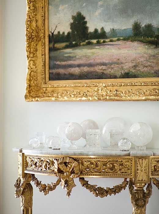 While most of her furniture leans more tailored, Suzanne mixed in a few ornate elements for contrast. Case in point: this gilded console, which houses her collection of rock-crystal spheres.