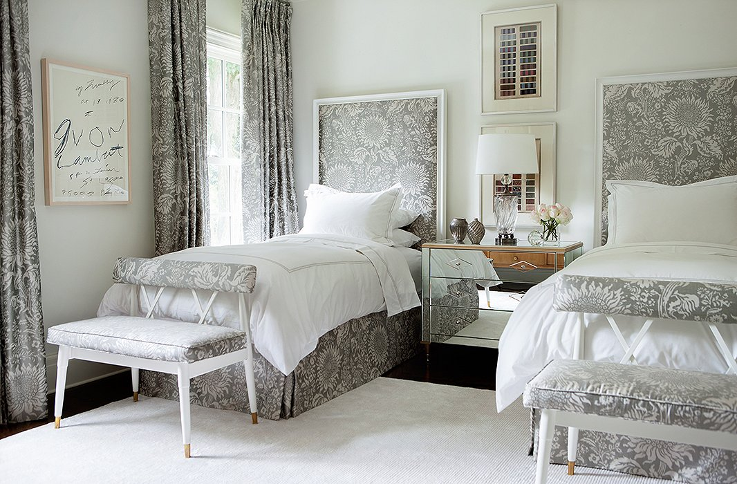 Taking cues from French design, Suzanne repeated a patterned fabric (by Brunschwig & Fils) throughout this guest room. The ribbon artwork above the nightstand comes from Suzanne's own collection for Soicher Marin.