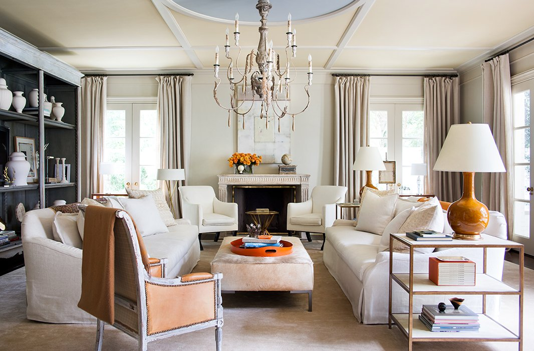 Classic Home Decor With Traditional & French Style. Suzanne added these geometric moldings to the family room ceiling, giving the space more of a presence. Painted ice blue, the center circle sets off the room's orange accents. #livingroom #traditionalstyle #classicdecor #elegance
