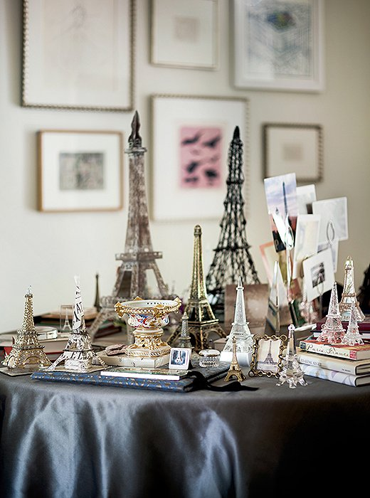 An avowed Francophile, Suzanne has amassed a collection of Eiffel Tower figurines over years of travel. Together they give pop and personality to the upstairs landing.