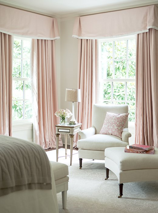 Classic Home Decor With Traditional & French Style. What guest wouldn't want to curl up in this sunny corner? Swathed in white and shell pink, the room is a dreamy confection. #bedroomdecor #palepink #classicdecor #Frenchstyle