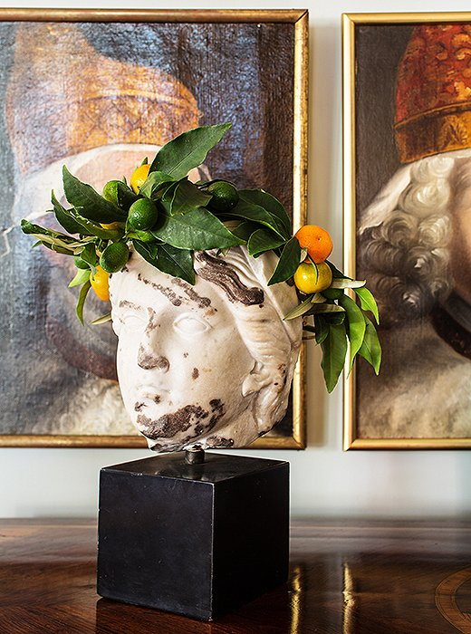 A bust is given a Christmas makeover with her beloved citrus and greenery.