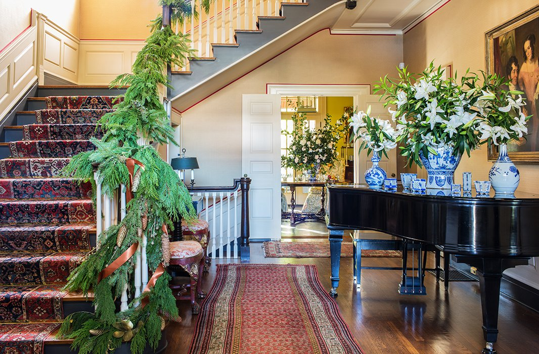 The piano provides another opportunity for Rheinstein to showcase her collection of blue-and-white vases and accessories—and to show off another bold arrangement.