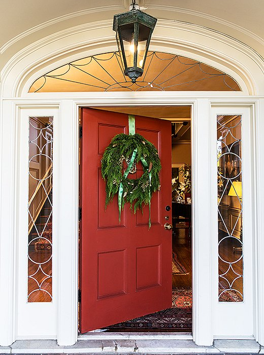 A simple boxwood-and-pinecone wreath works especially well with traditional architecture. Leaving the bow untied adds a bit of tossed-off glamour.
