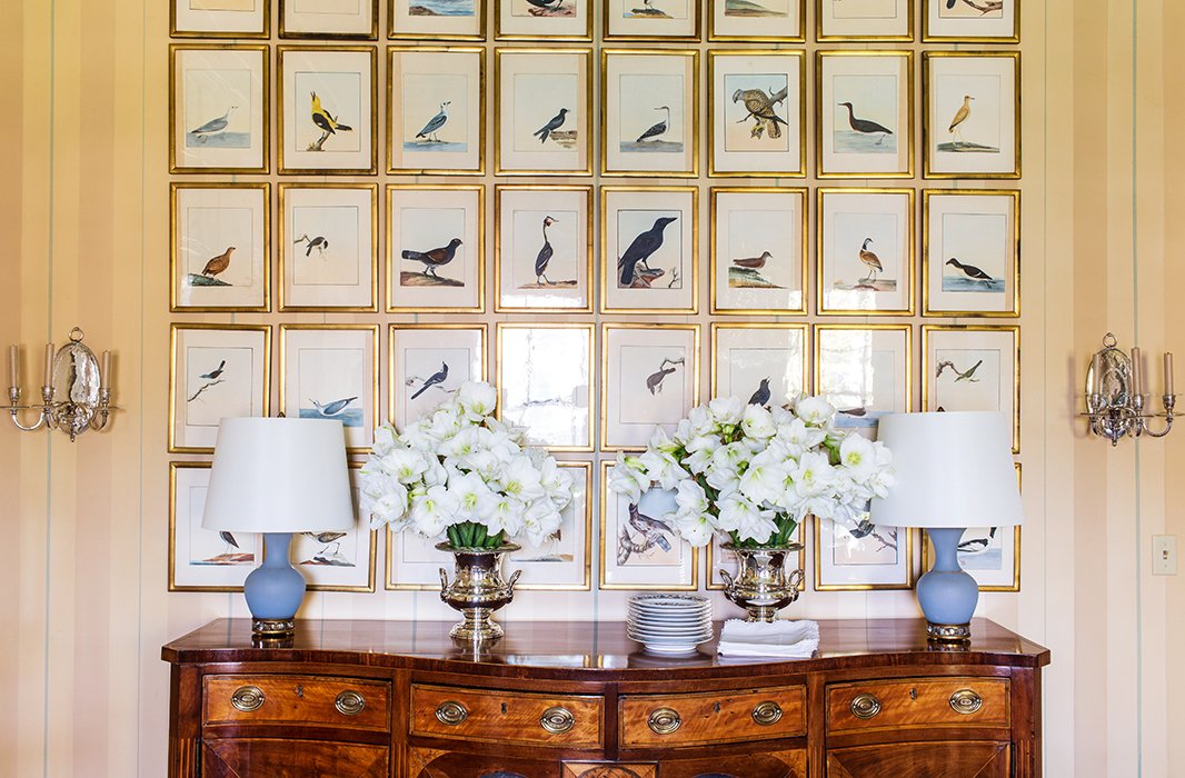 The bird prints, from a vintage ornithological book, were framed 18th-century style in a sculpted glass to create that beautiful, but not overly glossy, reflection.