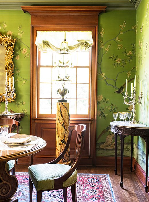 Timothy uses Roman shades throughout the house so as not to obscure the beautiful moldings and casements around the windows; when used for dining, the room is lit entirely by candelabras.