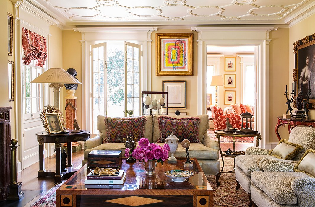 Timothy's richly layered living room combines the modern (including a Timothy Corrigan Home coffee table and a colorful portrait of Timothy by Don Bachardy) with antiques including a red 18th-century Venetian table.