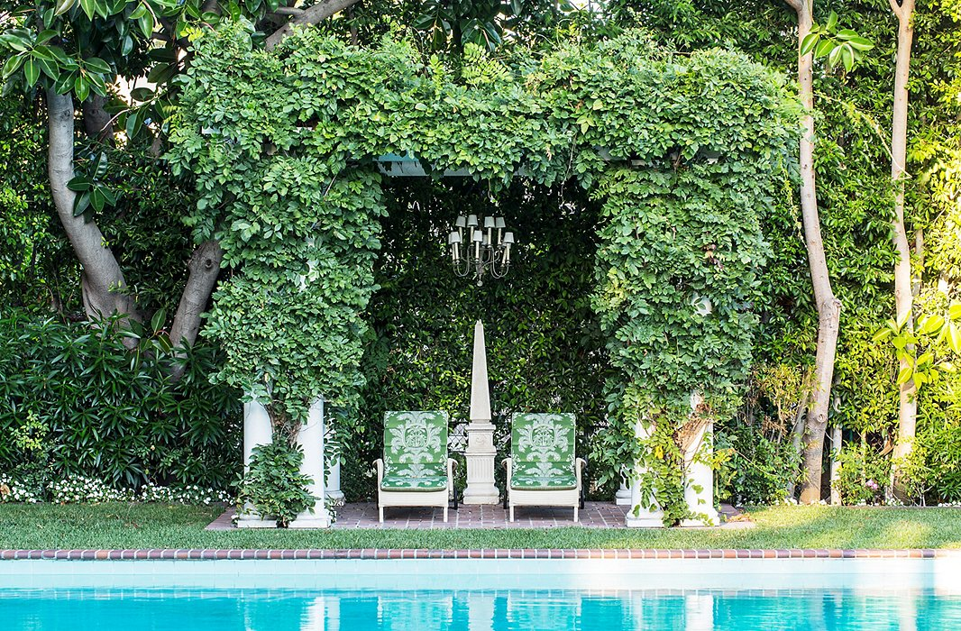 "Timothy doesn't swim many laps these days—and has an explanation few interior designers can match: ""I burned out."" As a youth, he swam six or seven hours a day and made it to the Olympic trials at age 18 (sadly, he didn't make the team). The pergola covered with wisteria and a chandelier create an ""outdoor living room."""