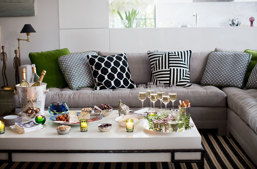 Given the apartment's compact layout and lack of a formal dining space, entertaining is always intimate and takes place around the living room coffee table and sectional, which comfortably seats eight.