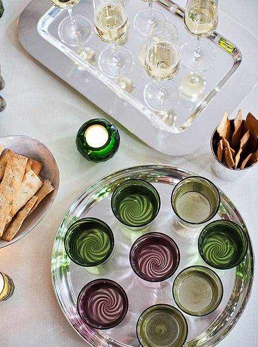 The vintage green David Hicks tumblers were found in Paris, and the Venini swirl glassware is from Paris boutique Muriel Grateau.