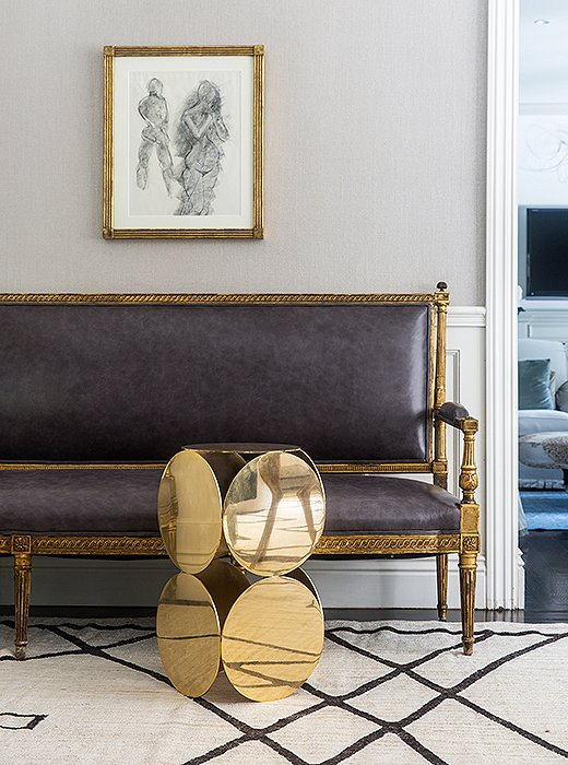 Gold finishes, ranging from polished to beautifully tarnished, act as a unifier that makes this seating area shine.