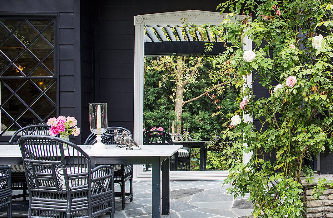 An oversize statement mirror sets a grand tone in the garden, amplifies changing daylight, and magnifies the surrounding lush greenery.