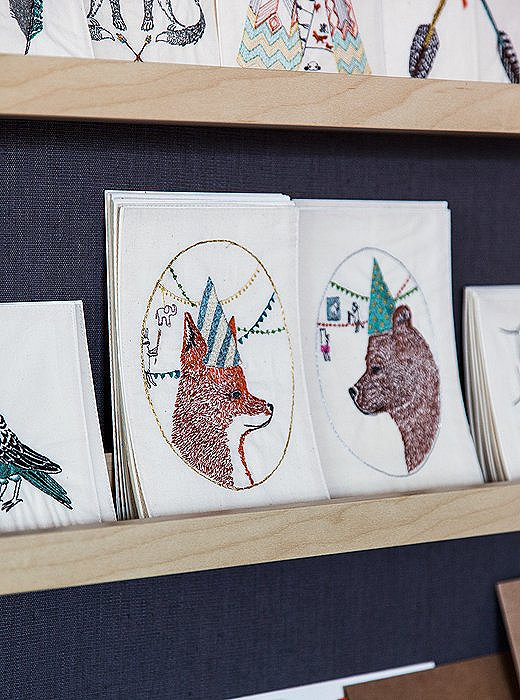 A fox and a bear face off on embroidered birthday cards, meant to be cherished as keepsakes rather than recycled like paper cards.
