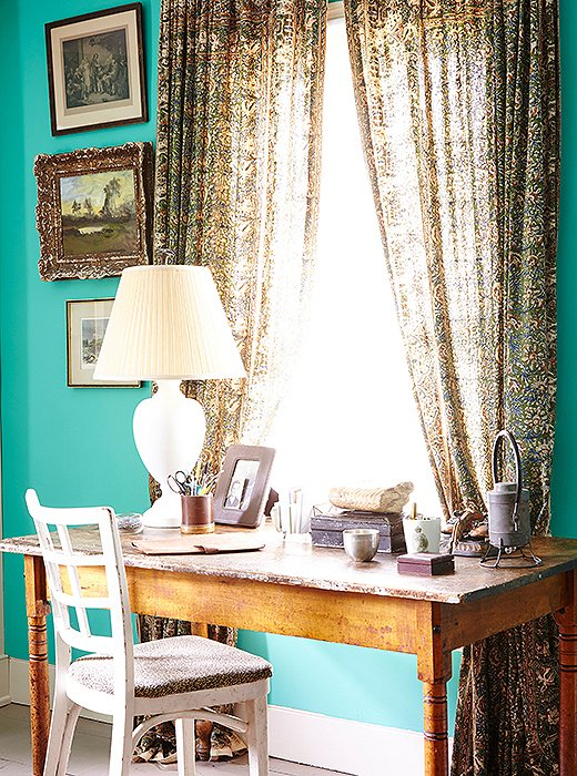 When guests aren't present, the guest room is used as Philip's dressing room and study; the curtains are made of Indian bedspreads found online.