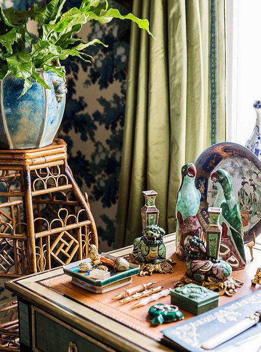 "A vignette on Alex's desk unites two of his collecting passions: animal motifs and chinoiserie. He's also a big proponent of indoor plants. ""It's important to have living things in the house other than the people."""