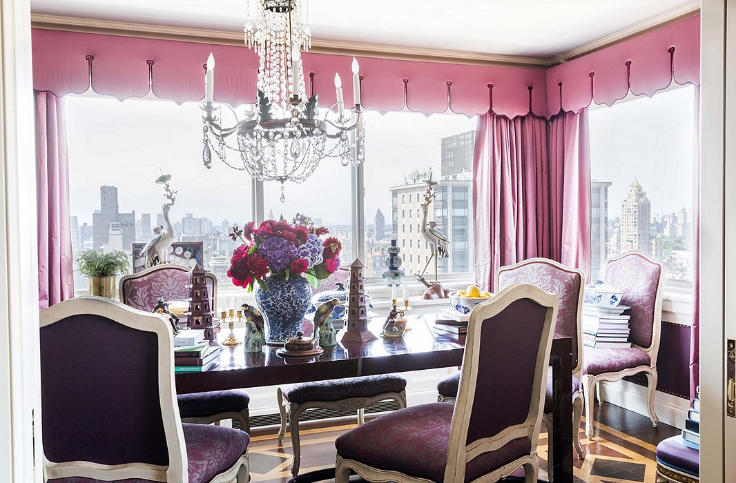 An array of purple hues turns the dining room into a jewel box. The living and dining room floors feature complementary parquet patterning, each created with a stencil. Shop an array of crystal chandeliers here.