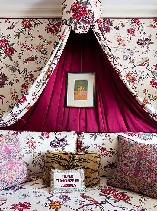 """Alex lined the daybed canopy with red satin to create a break from the pattern. """"There's an important balance between decorating and overdecorating,"""" he says."""
