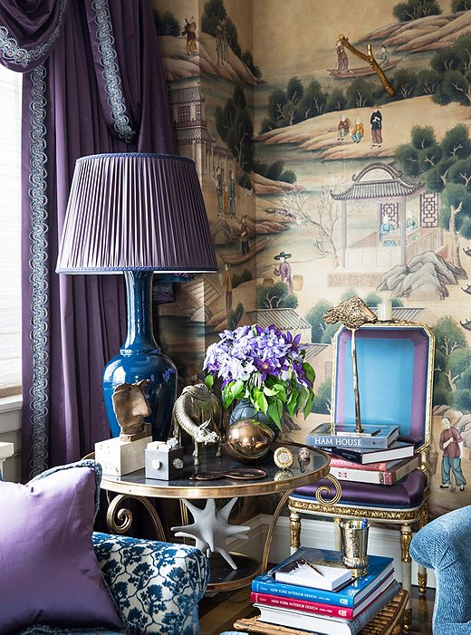 A gilded table that belonged to the designer's mother houses a collection of treasured objets. The inky-blue glazed lamp was created by Alex for Christopher Spitzmiller.