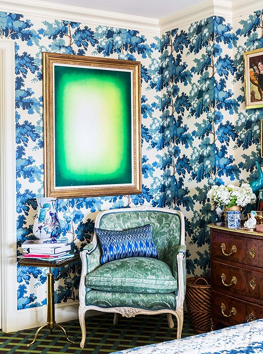 Green Shadow by Anish Kapoor hangs over a chair upholstered in Fortuny fabric, used on the reverse for a more antique look. The Swedish wallpaper from Old World Weavers was inspired by the Château de Groussay.