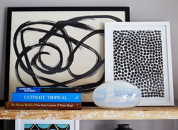 Framed art and photographs leaned against the wall make for a casually stylish shelfscape.