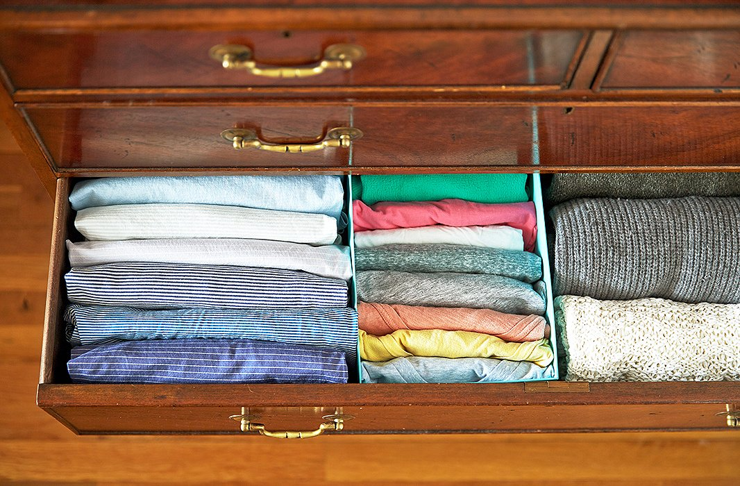 The dresser install, using a few shoeboxes. I even folded some of my husband's striped shirts (on the left), just to inspire him to try this in his own drawers.