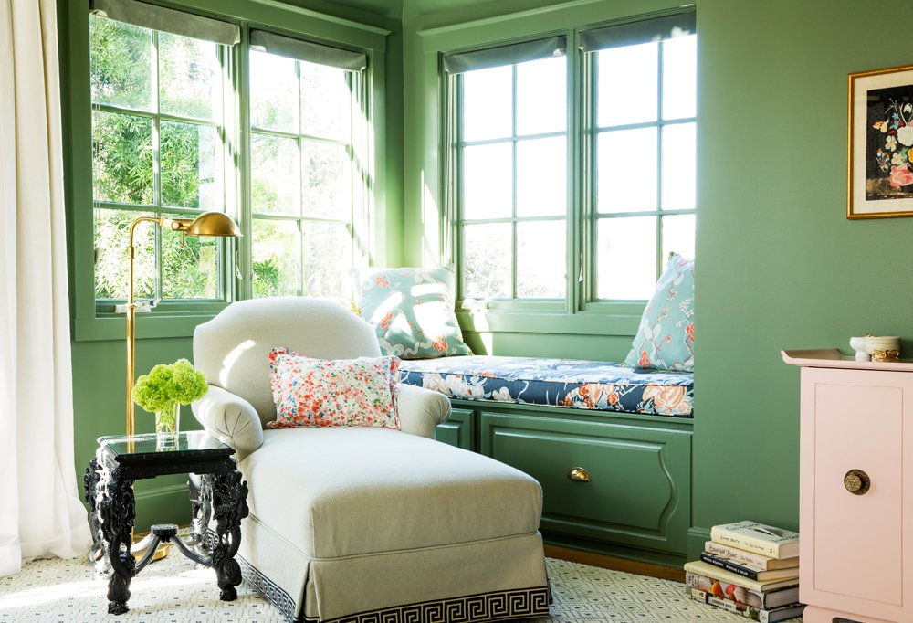 Chloe opted for multiple patterns in this beyond-bright corner, from the Greek key print on the chaise to the Bob Collins and Peacock Alley fabrics on the window seat and pillows.