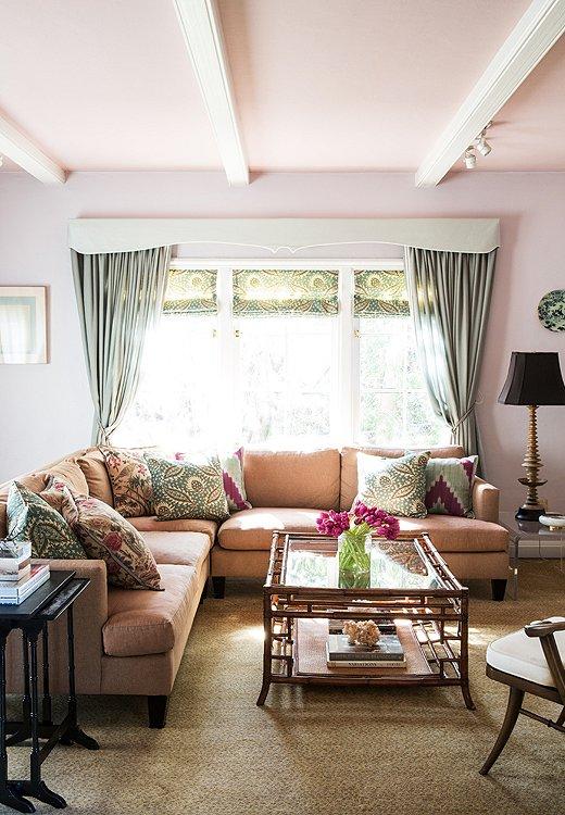 In Chloe's den, a Barbara Barry for Henredon sectional topped with custom pillows is backed by walls painted Philip's Perfect Colors' Dusk. Pink is one of the sweetly traditional shades that makes an appearance in many a Chloe project.
