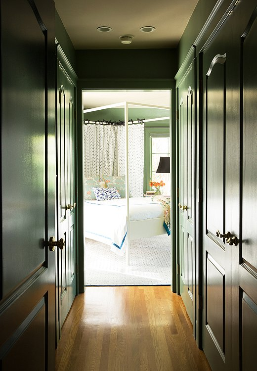 "After struggling with the design of her bedroom, Chloe got the jolt of inspiration she needed to finish it after painting it—moldings and all—Farrow & Ball's Calke Green. ""Suddenly it was the most exciting room in the house,"" she says."