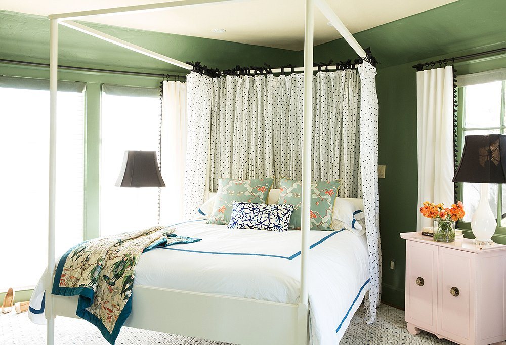 "Rather than fight the previous owner's bed-in-a-corner orientation, complete with a hanging pendant light and wall mounts, Chloe embraced it with an architectural canopied bed, which ""made it seem purposeful and not like a ship crashed in the corner."""