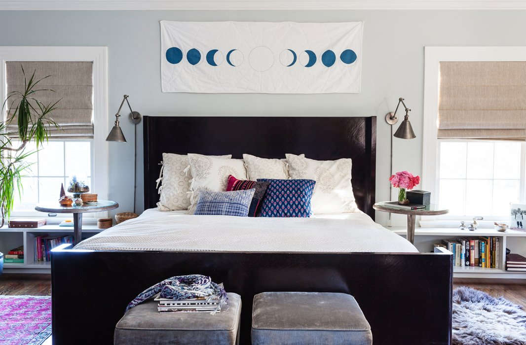 With walls painted Benjamin Moore's restful Wickham Gray and a Salt & Still quilt depicting the moon's phases, the master bedroom is primed for catching Zzzs. On the bed, a John Robshaw duvet works the same neutral color scheme as the Les Indiennes pillow shams.