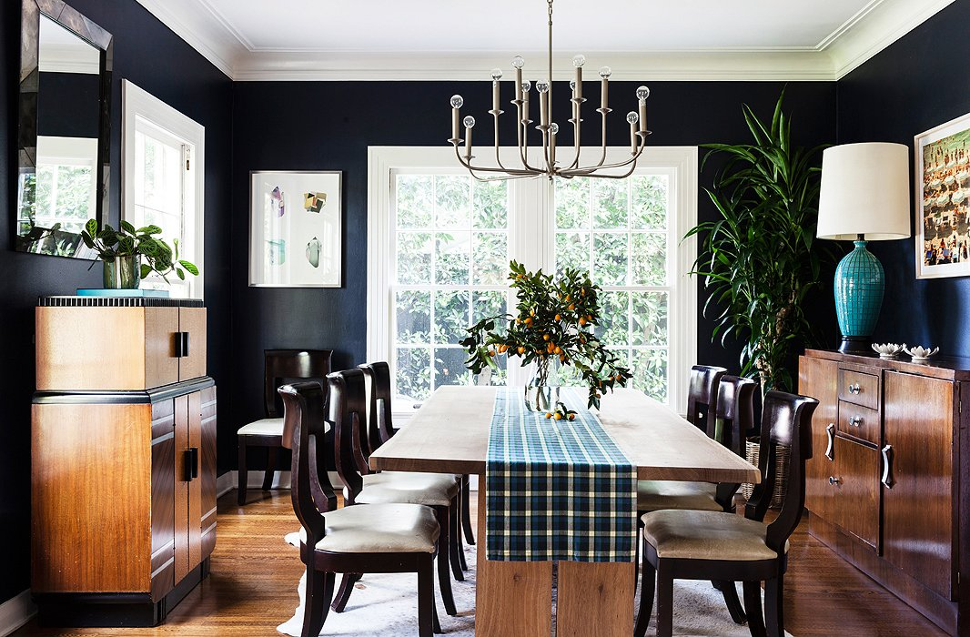 "Christine painted her dining-room walls Benjamin Moore's Polo Blue and juxtaposed them with some of her existing furniture, a new dining table, and a modern chandelier that's ""free and open, just like you'd want your dinner conversations to be,"" she says."