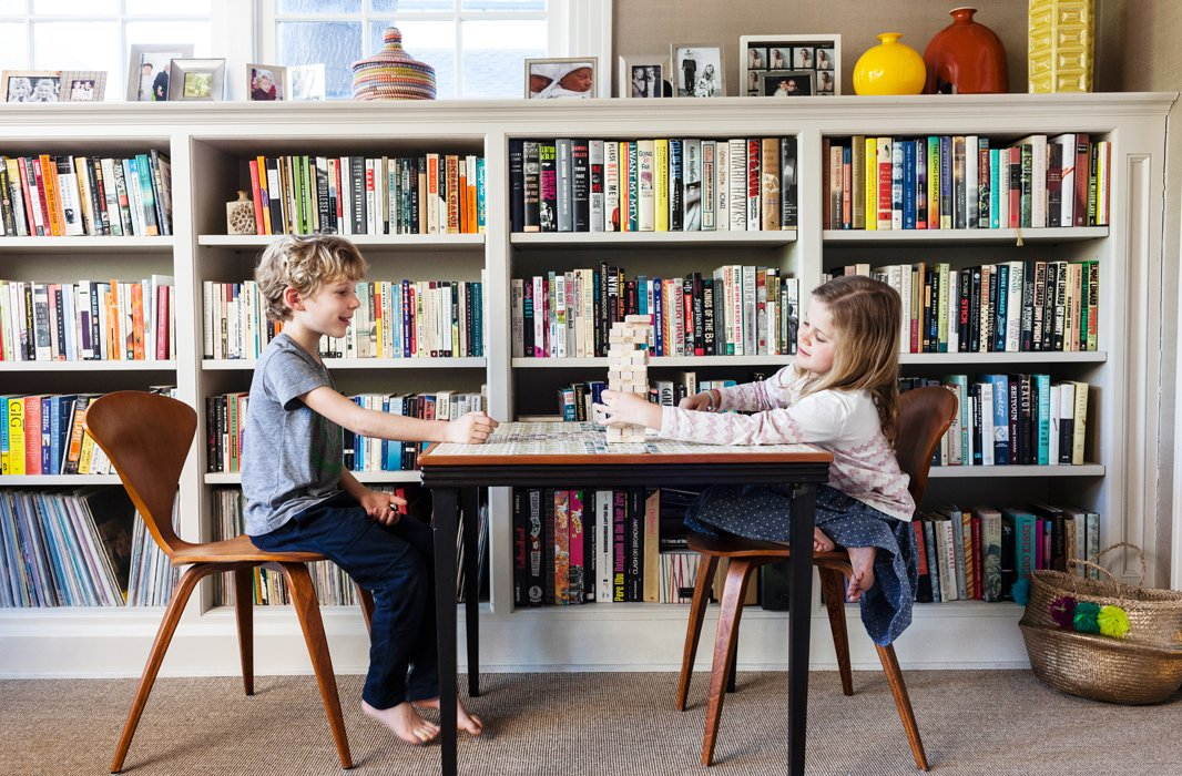 Eight-year-old twins Louis and Millie gather often for game time in the den like this round of Jenga.