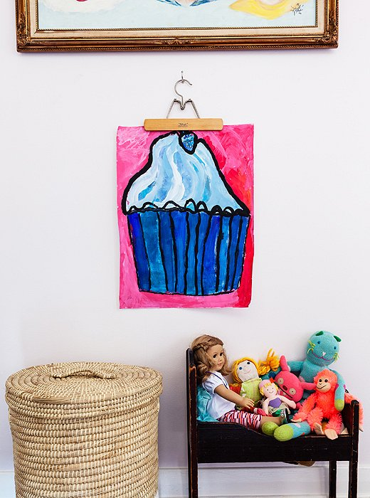 "Also in Millie's room is an abstract cupcake the budding artist painted herself, above a doll bed that's one of the oldest pieces in the house. ""My great-grandfather made it for my grandmother,"" says Christine."