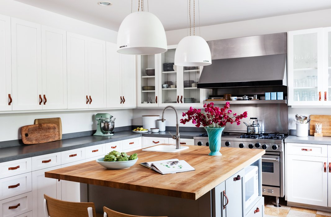 Christine's kitchen checks all the boxes for dream-kitchen status: Viking stove (inherited), butcher-block island (added), and cool pendants (from Schoolhouse Electric). But it's the quirky touches—leather door pulls, cork floors—that make it her own.