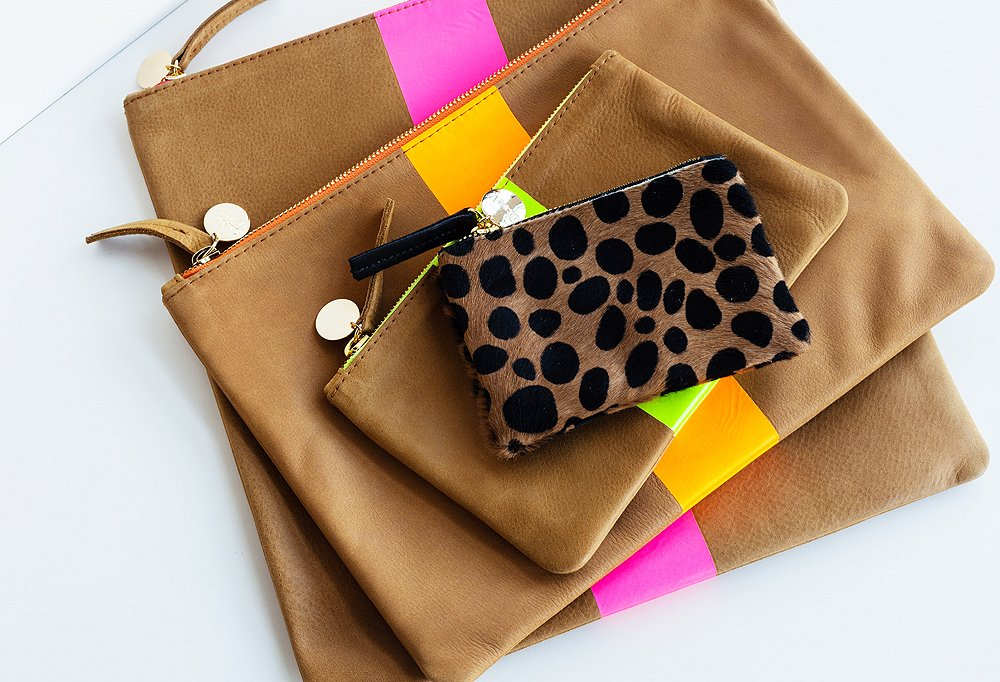 A petite but punchy leopard wallet clutch tops a stylish stack.
