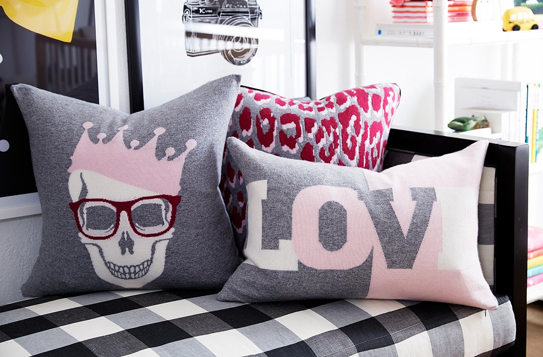 The softer the better: You can never have too many blankets and pillows. Here, we layered in some softer pinks, in the form of graphic designs and animal prints.