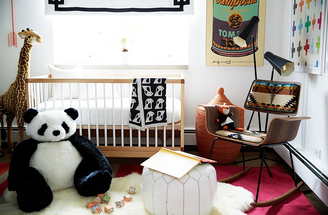 The crib fit perfectly under the window, and a blackout shade backed in white linen was added for nap time. The black-and-white contrasts are played up with a giant panda.