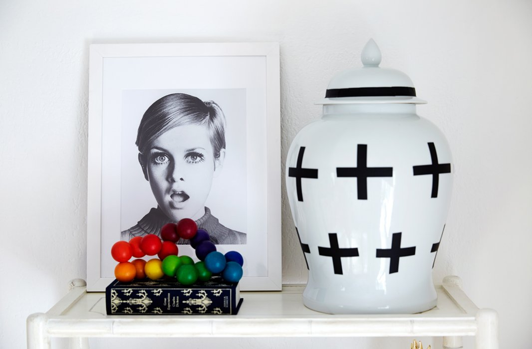 A black-and-white Twiggy portrait is a fun nod to Coco's professional life. The ginger jar, originally a plain white, was made into a graphic piece with the addition of an eye-catching black motif.