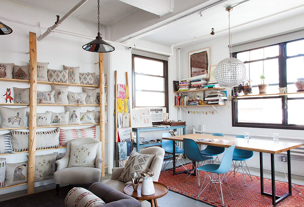 """""""We eat lunch every day at that table by the window,"""" says Housley. """"I love where the studio's located—being able to see the train pass by and people walking down the street, to pick up on the flow and energy happening right outside."""""""