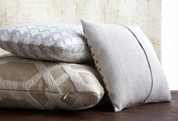 Clockwise from top left: a no-closure pillow, a pillow with a sham closure, and a pillow with a zipper closure.